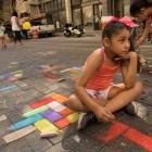Sophia Mata, 8, draws a pattern on Houston Street at Chalk It Up.