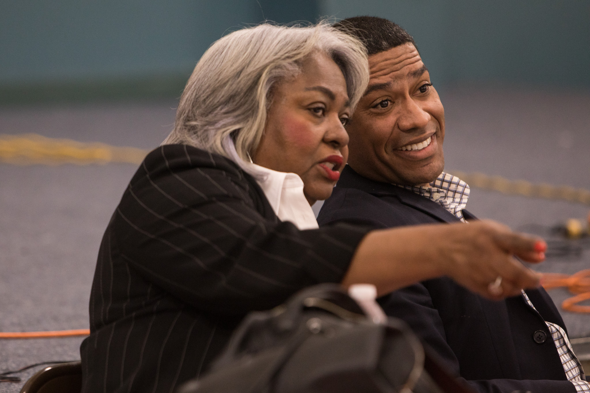(From left) Rep. Barbara Gervin-Hawkins (D) and Councilman William 'Cruz' Shaw (D2) whisper to one another during a town hall meeting with the Government Hill Alliance Neighborhood Association at St. Patrick Catholic Church.