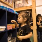 (From left) Daniella Zapata, 1, and Natalie Zapata, 3, play in the kid care center at the SJRC Texas Pregnant Parenting Teen Program.