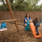 SJRC Texas Director of Child and Family Services Christina Melendrez plays with Daniella Zapata, 1, on the playground at SJRC Texas Pregnant Parenting Teen Program.