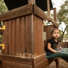 (From left) Natalie Zapata, 3, and Daniella Zapata, 1, play on the playground at the SJRC Texas Pregnant Parenting Teen Program.