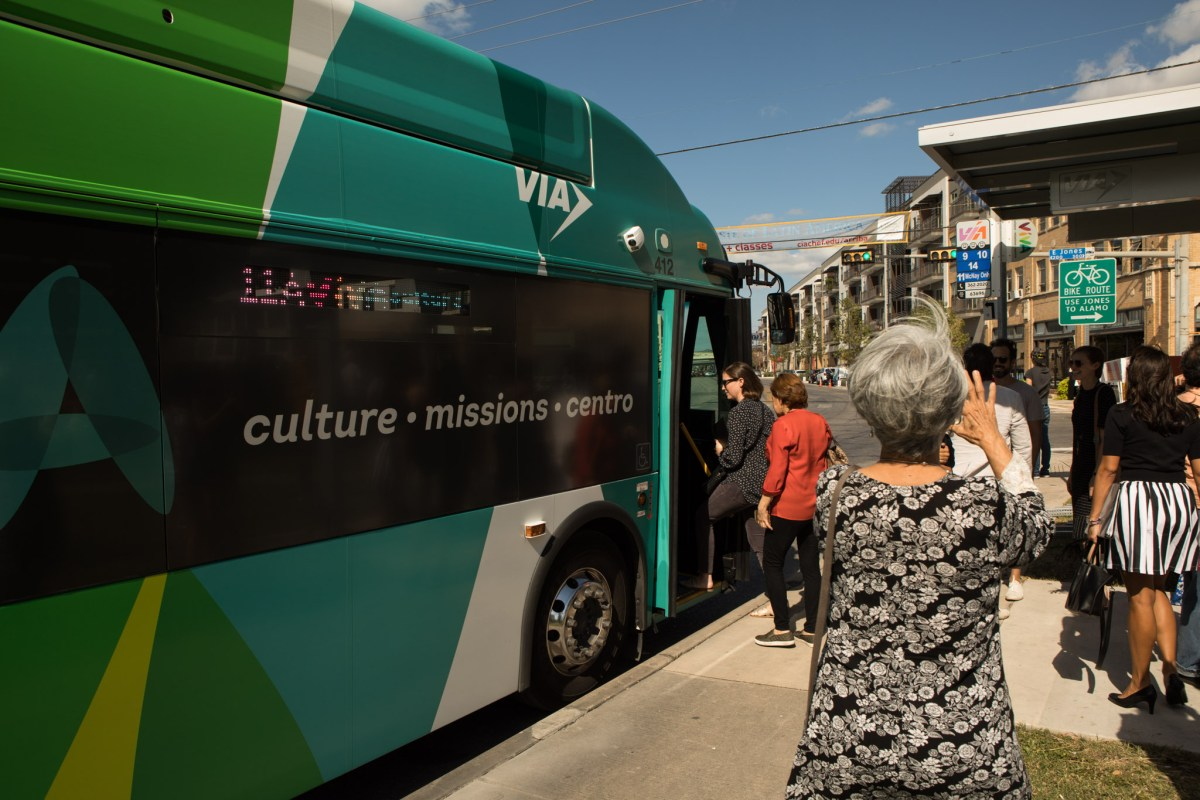 People board a VIA Metropolitan Transit bus at the intersection of Broadway Street and Jones Avenue.
