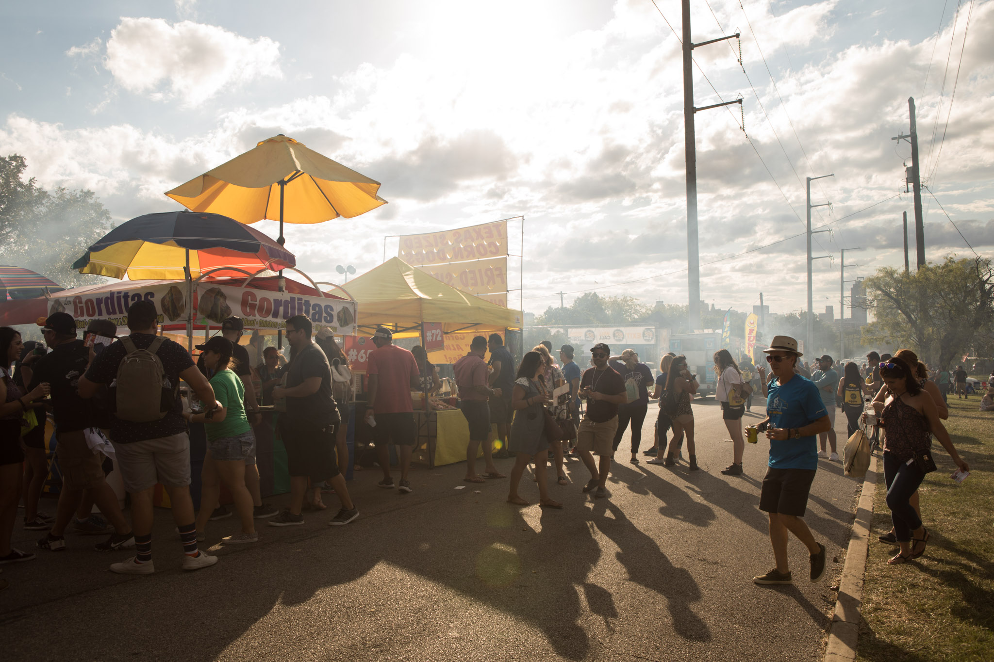 Crowds of people wait for food and beer at the San Antonio Beer Festival.