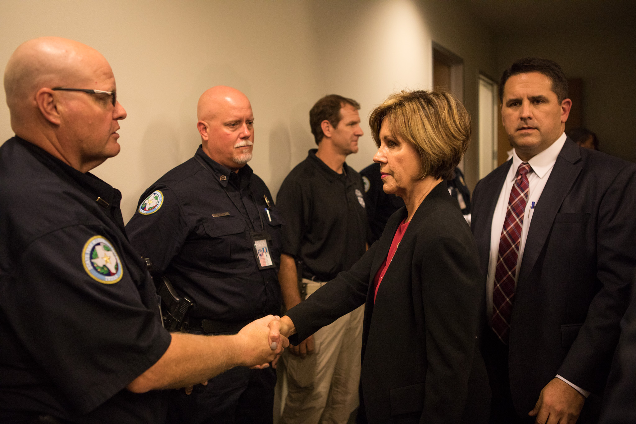 City Manager Sheryl Sculley shakes hands after a press conference regarding the Ingram Shopping Center fire investigation.