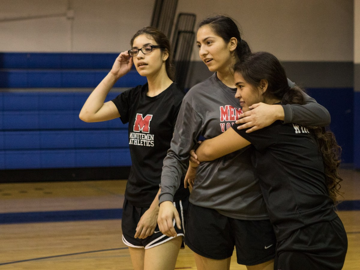 (From left) Sara Vasquez, Tiffany Lopez, and Samantha Rios wait for their drill during volleyball practice at Memorial High School.