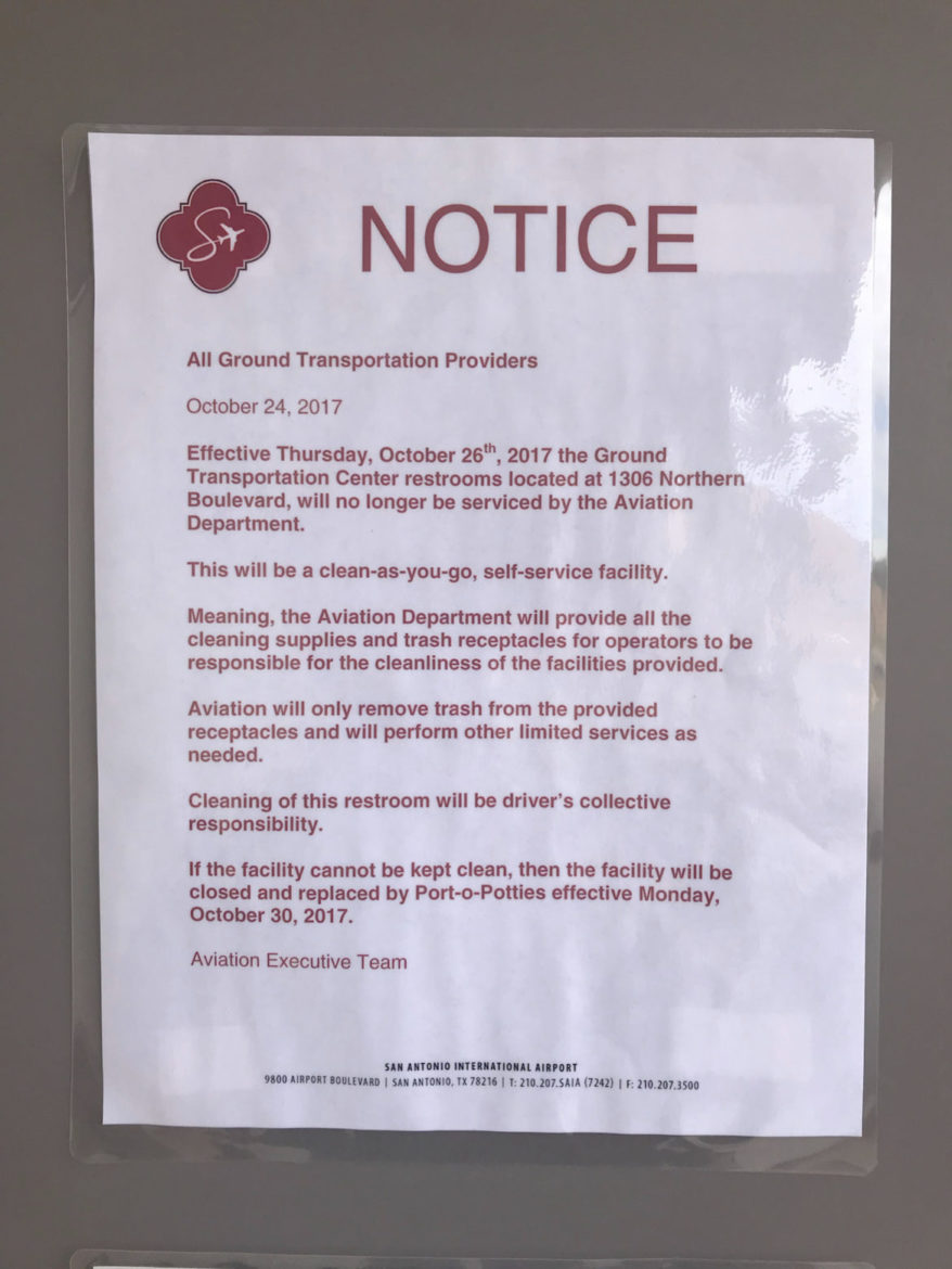 A notice posted on the bathroom doors of the orange lot facilities.