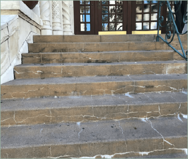 Cracked steps leading to and from City Hall.