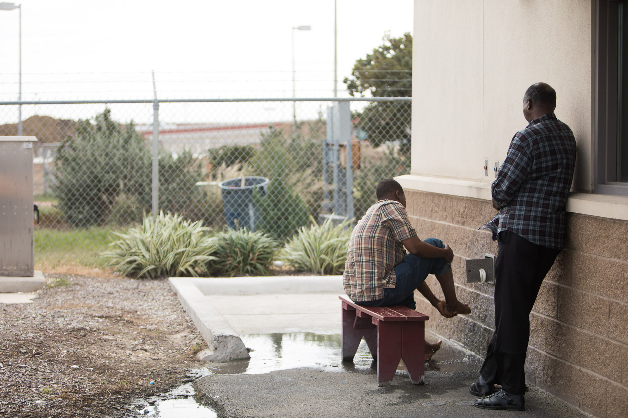 Men of the Muslim faith wash their feet on the side of the facility.