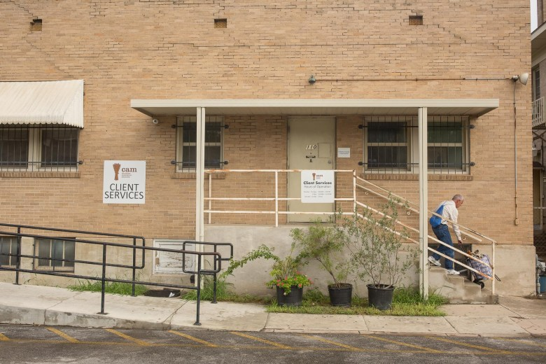 A client exits the building at Christian Assistance Ministry on McCullough Avenue.