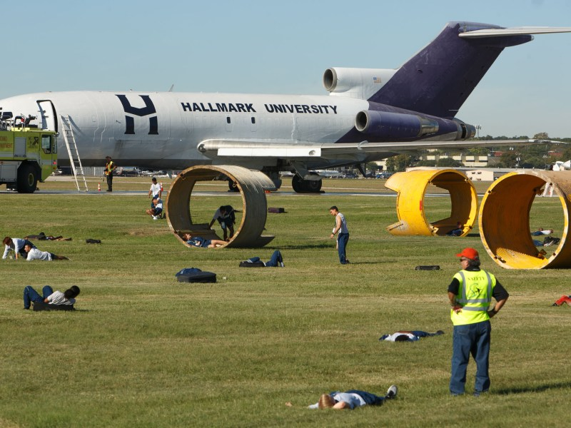 Emergency responders and volunteers manage the scene of a mass casualty incident during a drill at San Antonio International Airport.