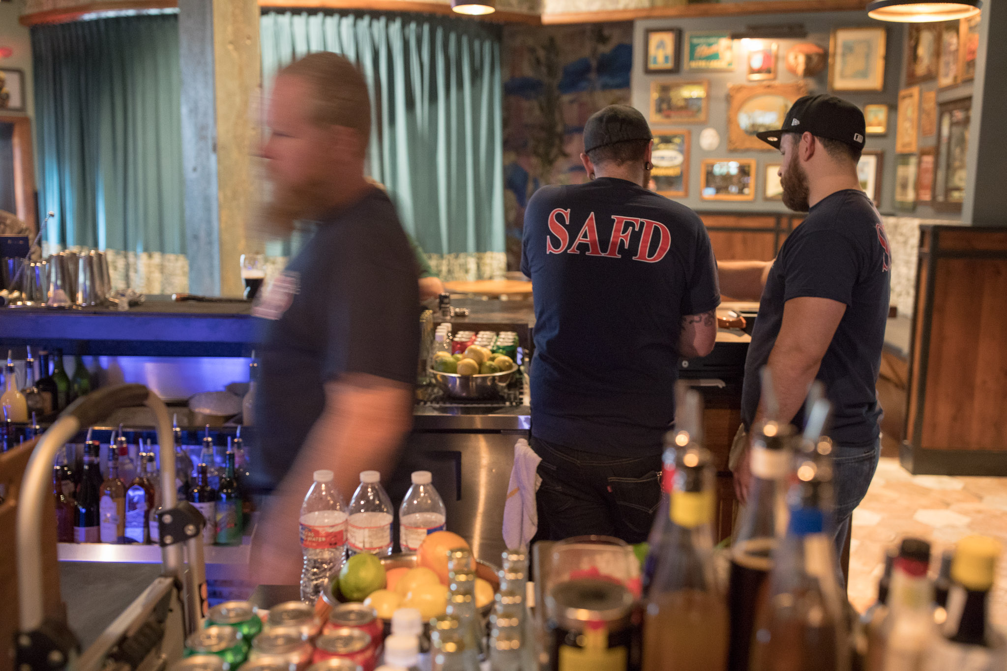 Francis Bogside employees wear SAFD shirts on the first day of reopening after a fire closed the popular pub down in 2016.