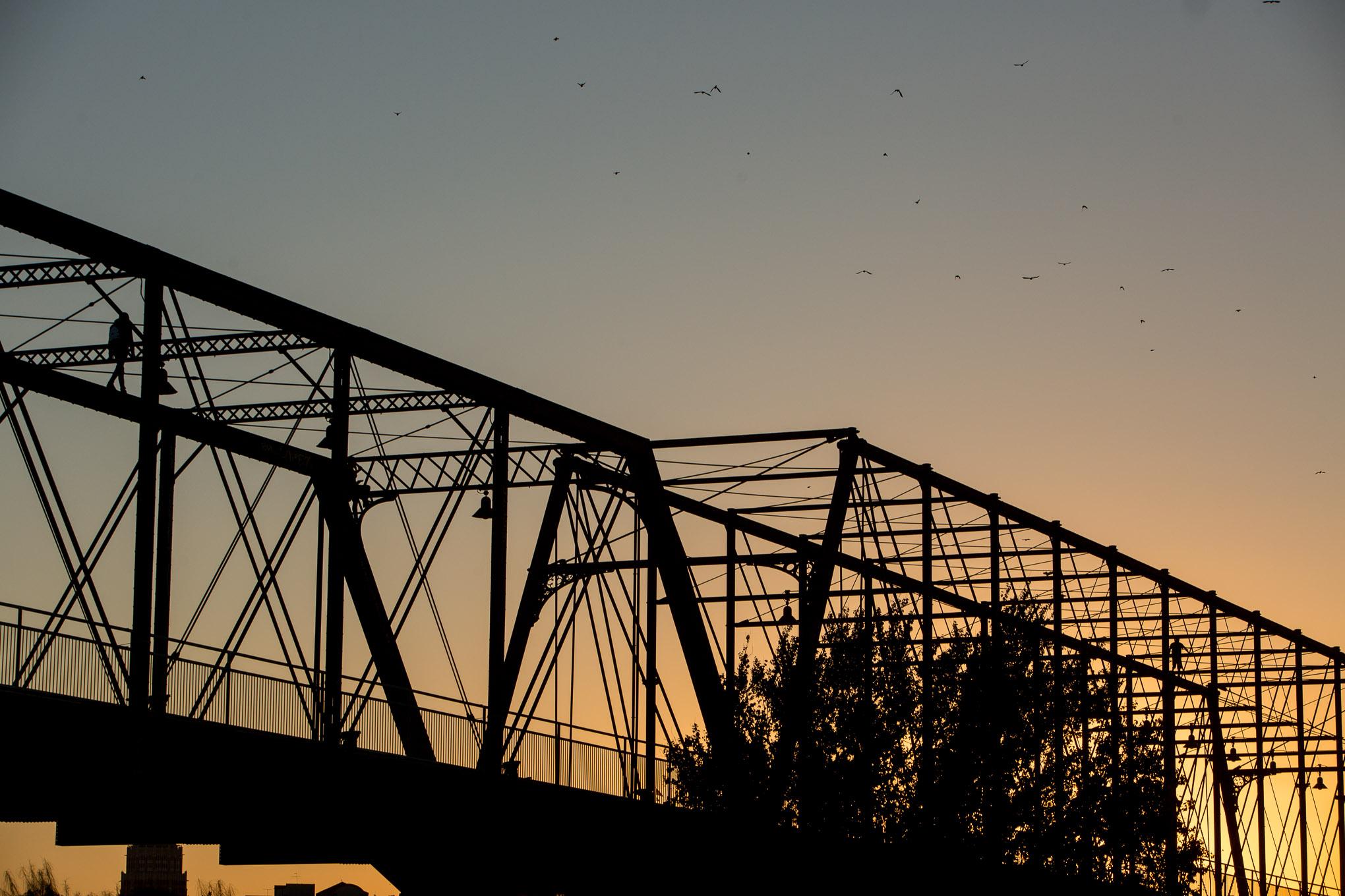 The sun sets over the Hays Street Bridge.