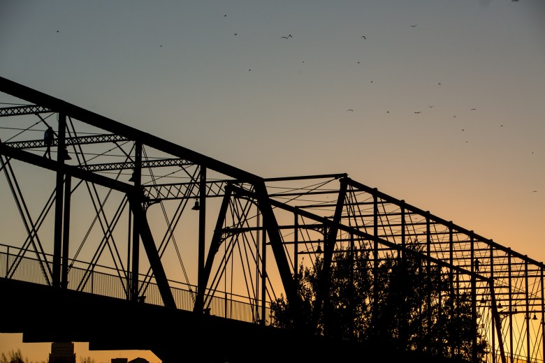 The sun sets over the Hays Street Bridge.