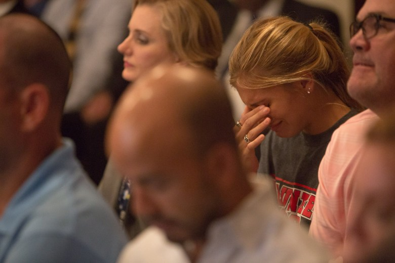 Kendall Kloza cries during the NEISD board meeting as the proposed name change to her school are discussed.