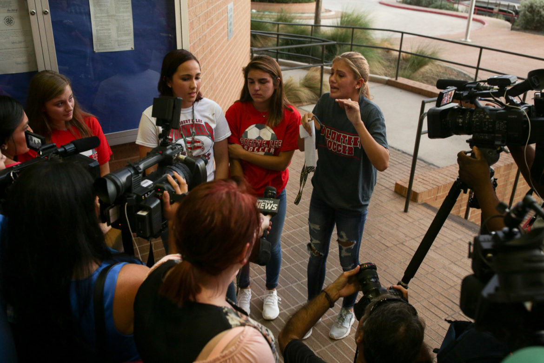 (from left) Seniors Selah Evans, Savannah Vathy, Kendall Kloza speak with reporters following the NEISD board meeting.