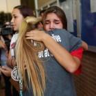 Kendall Kloza hugs following Senior and soccer teammate Savannah Vathy after the NEISD board meeting.