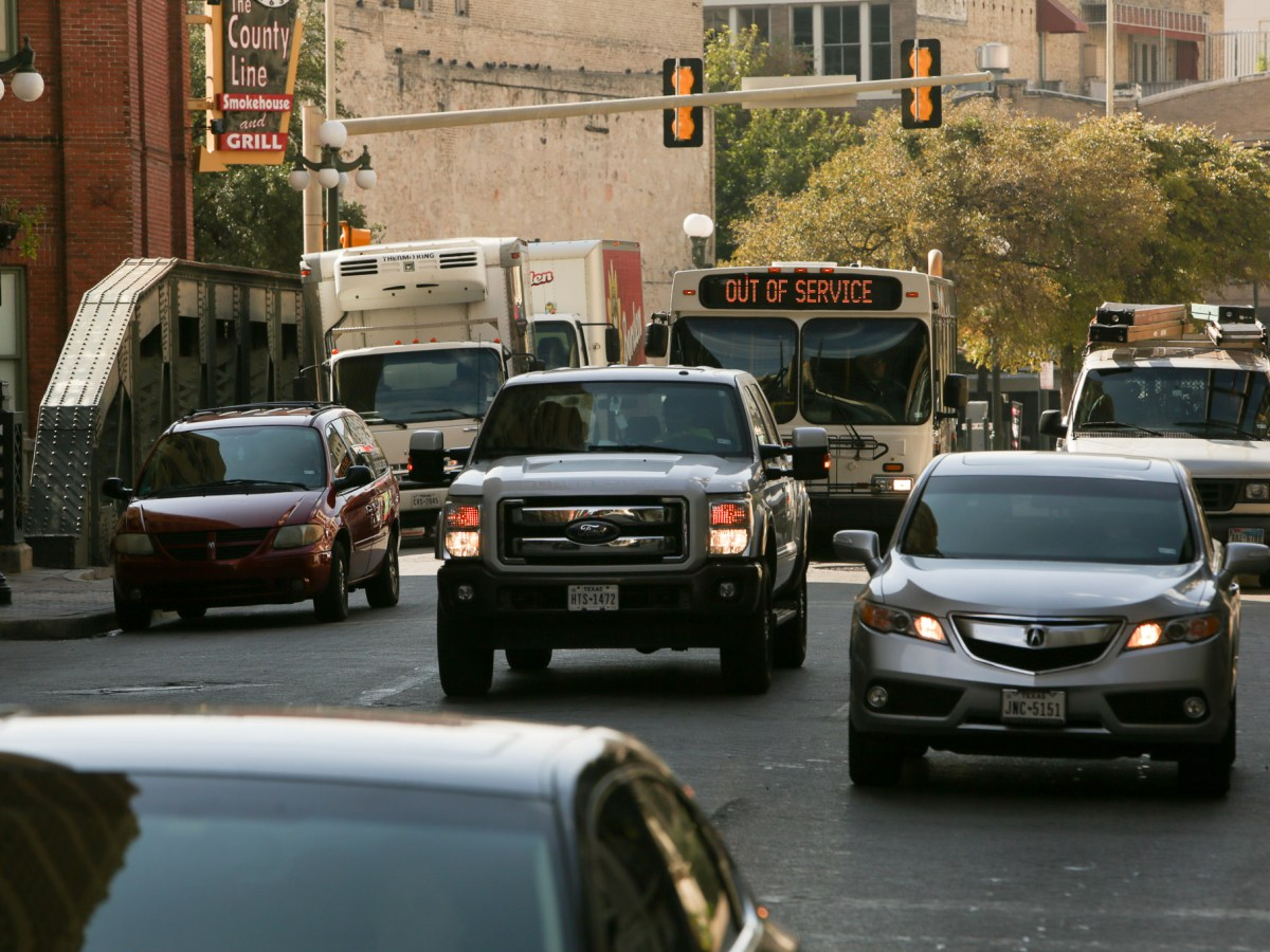 Vehicles travel North on Navarro Street in downtown San Antonio.