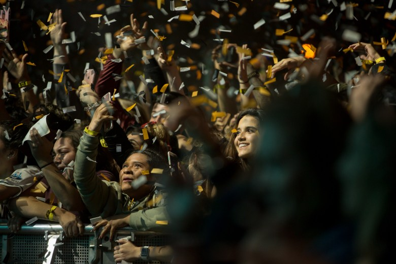Attendees are showered by thousands upon thousands of confetti pieces during the performance of Carnage.