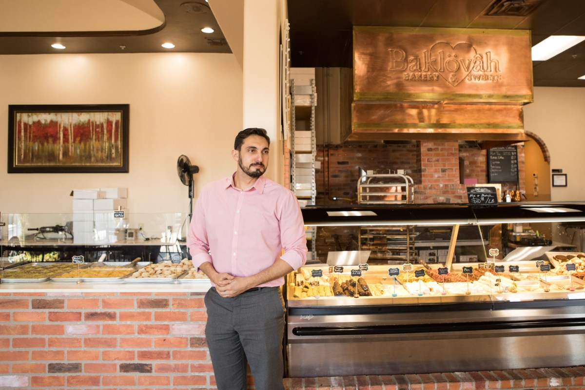 Bilal Deiri, Pasha Mediterranean Grill's director of operations, greets a customer at his other business, Baklovah Bakery & Sweets.