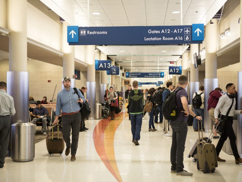 Travelers walk through Terminal A in San Antonio International Airport on the day before Thanksgiving.