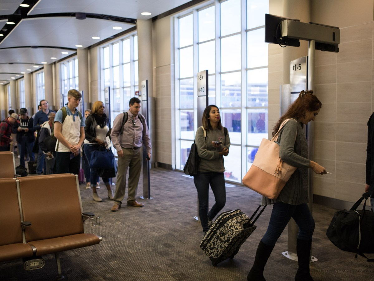A line of passengers enters the jet bridge to board a flight at the San Antonio International Airport on the day before Thanksgiving.