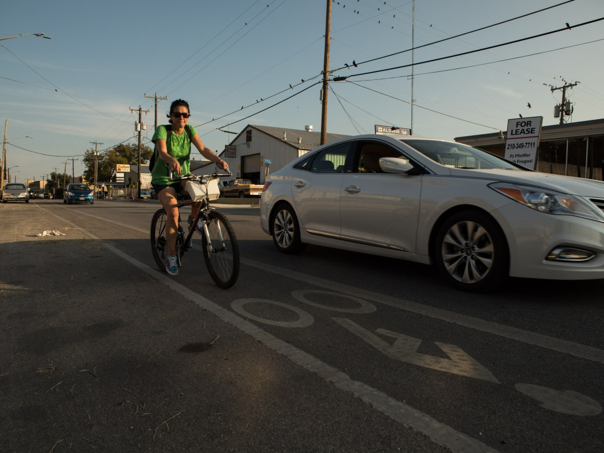A cyclist rides in the bike lane on Saint Mary's Street.
