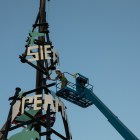 The last section of the Dream Song Tower is placed on the top of the structure.