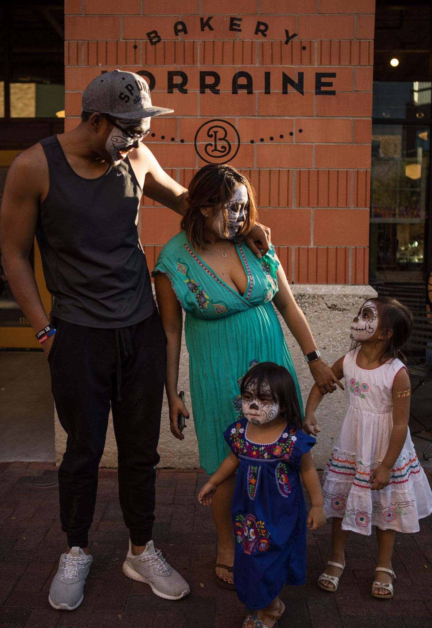 (From left) Adrian De Los Reyes, Camille De Los Reyes, Evie, 2, and Adrienne, 4, decorate their faces for Día de los Muertos at the Pearl.
