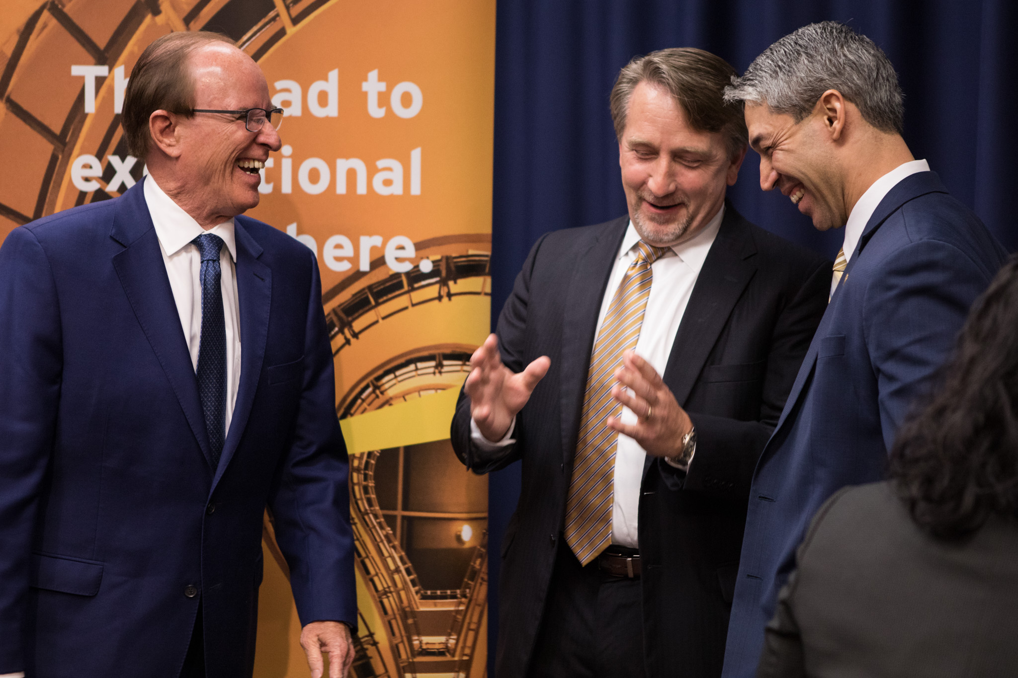 (From left) Bexar County Judge Nelson Wolff, Ernst & Young LLP San Antonio Financial Services Organization Southwest Market Segment Leader Jeff Rummel, and Mayor Ron Nirenberg share a laugh after the official approval of an incentive package for Ernst & Young financial services client service delivery center.