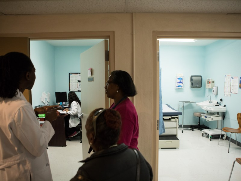 San Antonio AIDS Foundation Medical Director Wari Allison (left) gives a tour of the new Care Clinic.