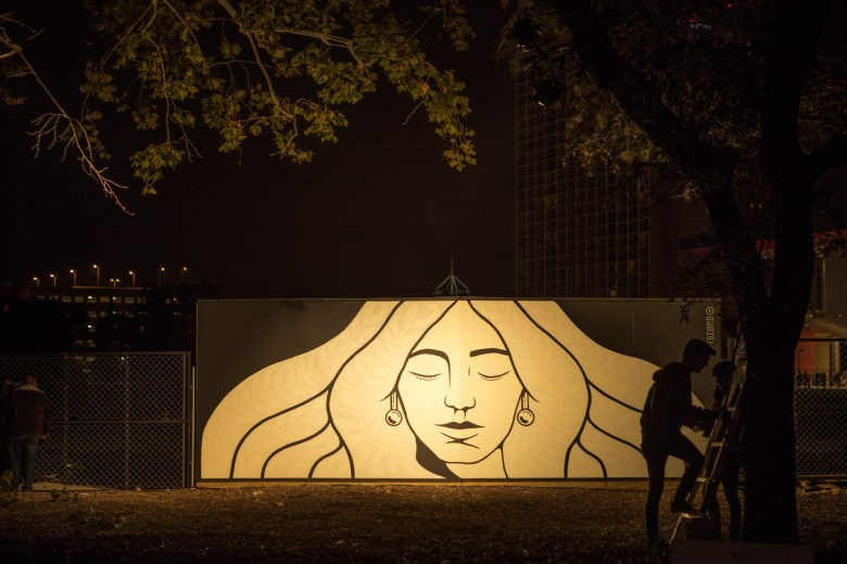 "Reskate's San Antonio ""chili queen"" mural greets visitors at the Hemisfair park entrance of Luminaria."