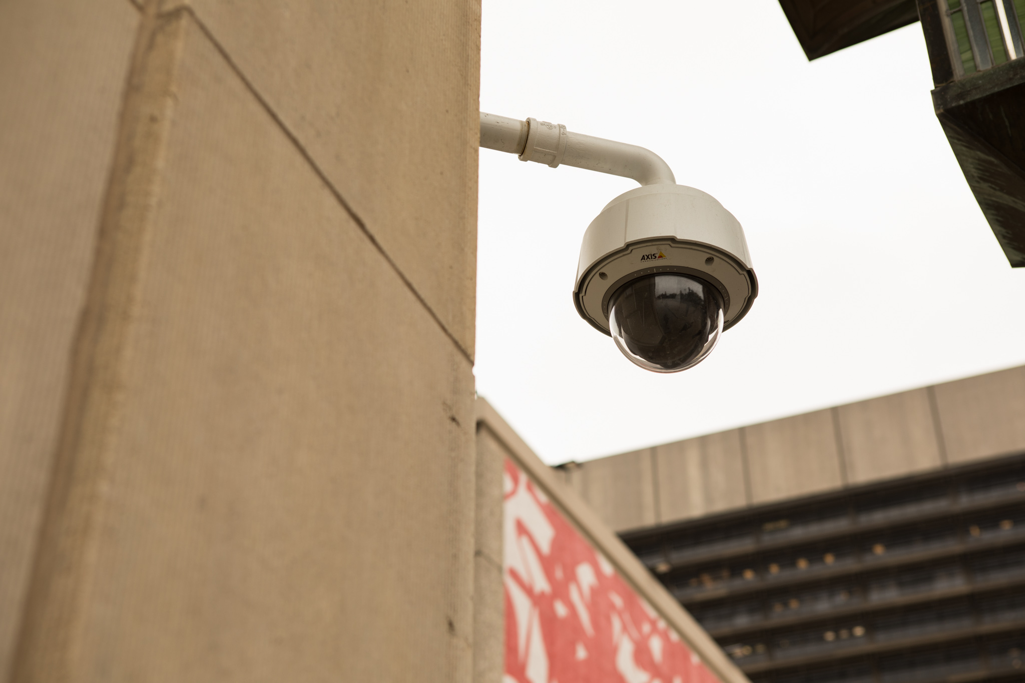 A security camera looks over the Municipal Plaza Building.