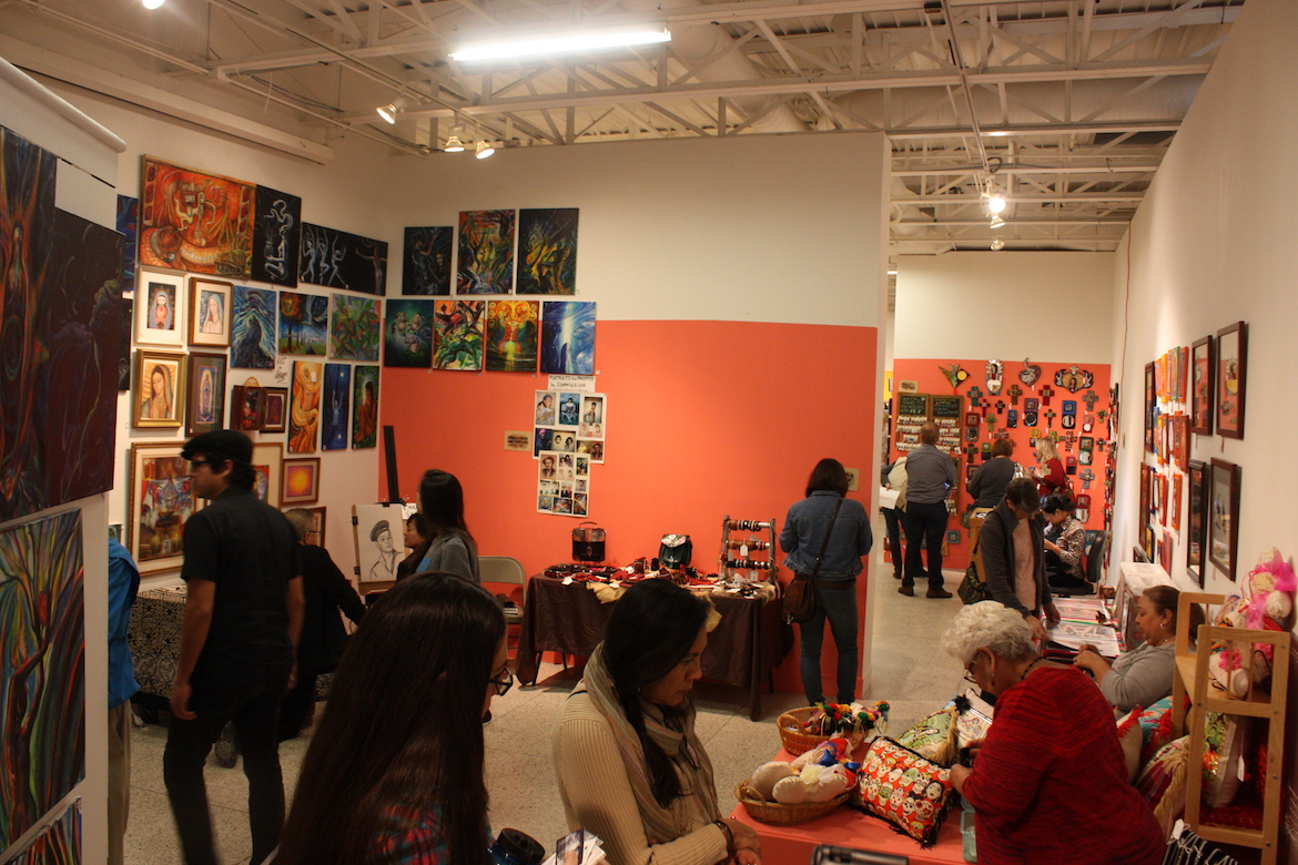 Attendees visit vendors at Hencho a Mano at the Guadalupe Cultural Arts Center.