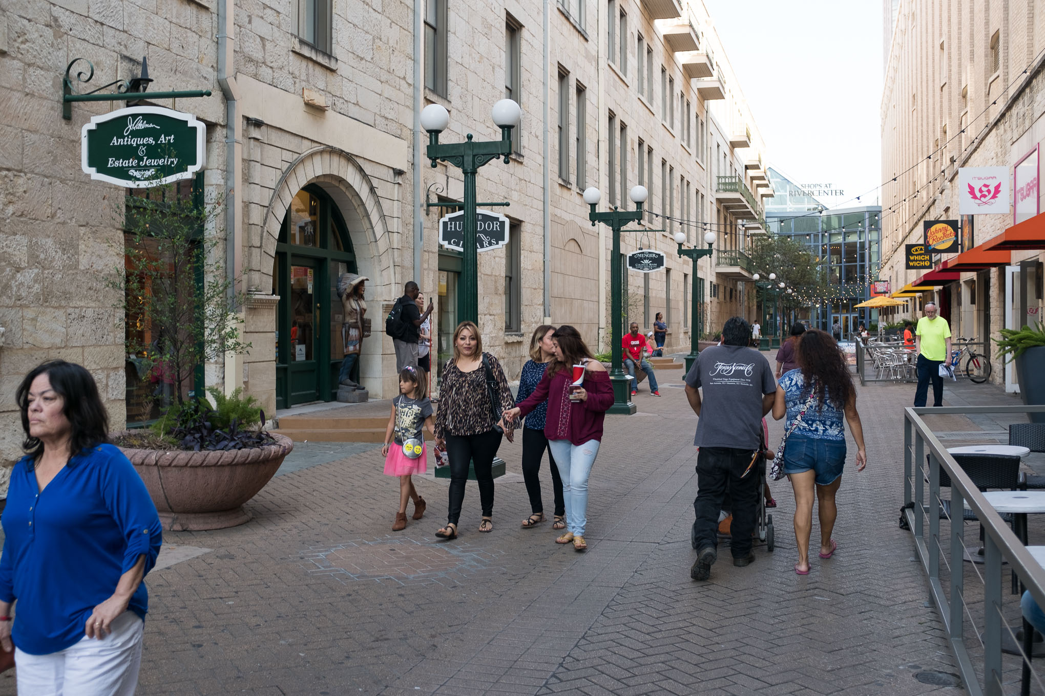 Customers walk outside the Shops at Rivercenter in downtown San Antonio.