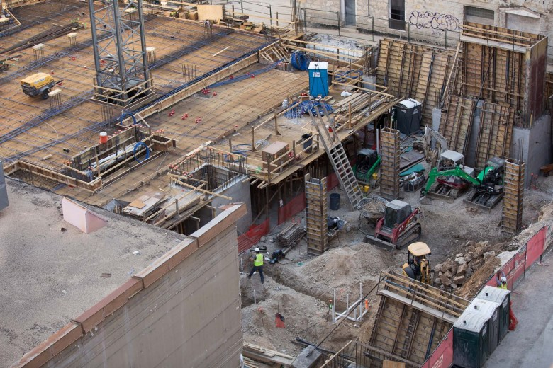 Construction continues along the historic Soledad Street.