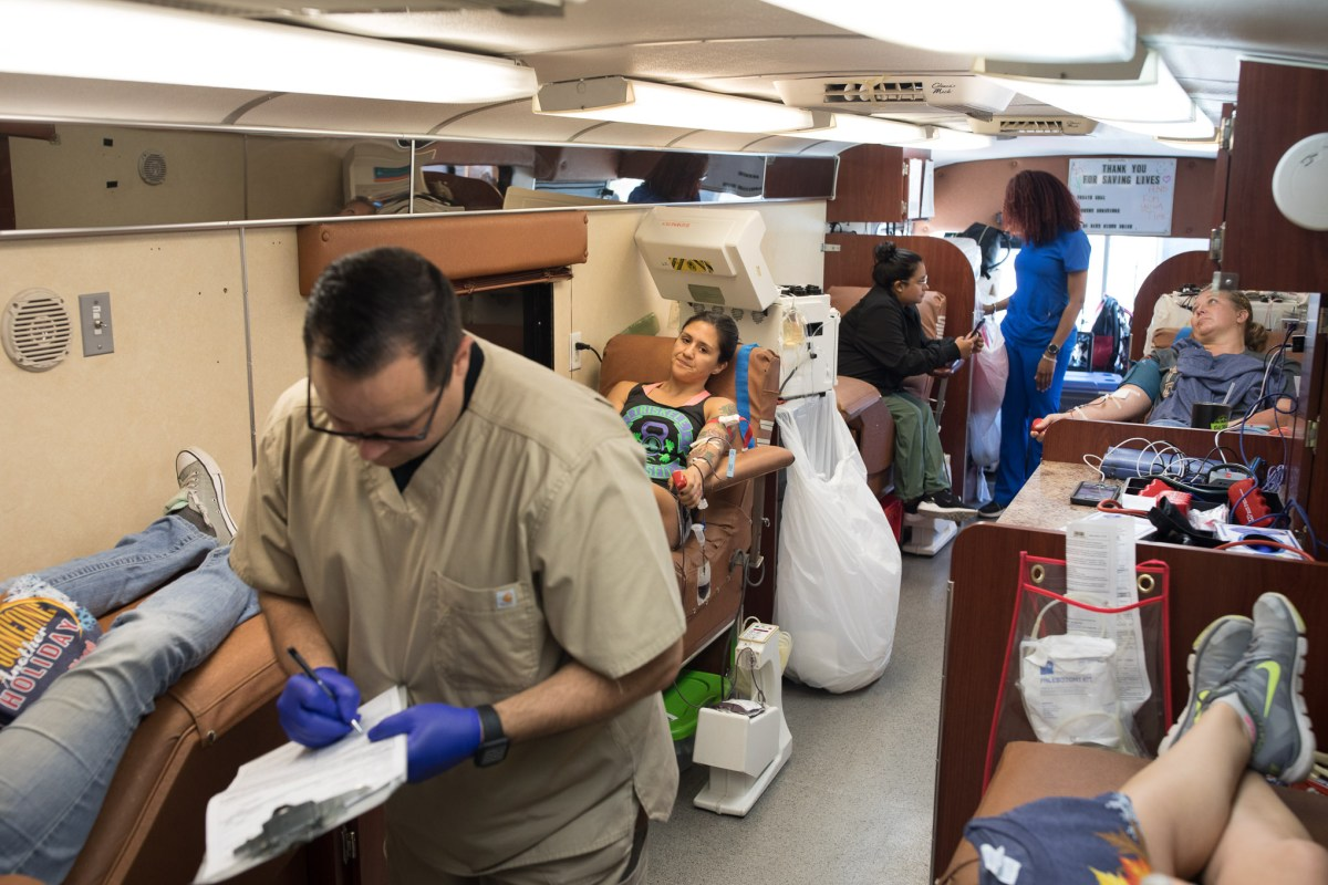 Blood donors fill the interior of a South Texas Blood and Tissue bus parked outside of Connally Memorial Hospital in Floresville, Texas.