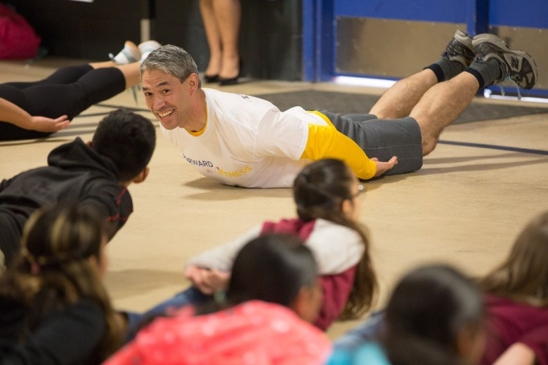 Mayor Ron Nirenberg performs trunk lifts with fellow students of William Pearce Primary school.