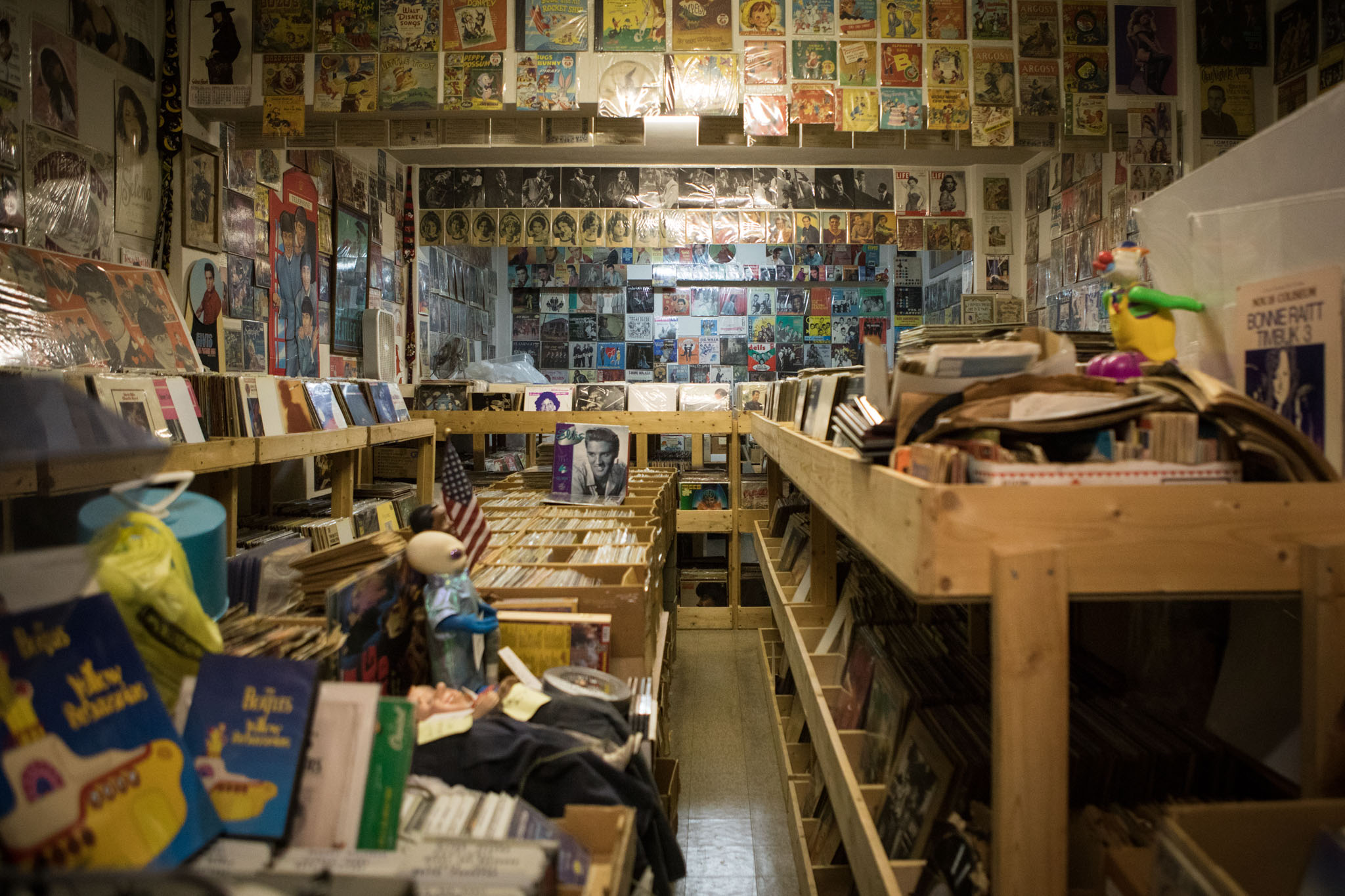 Records line the shelves and walls inside Alamo Records & Sheet Music.