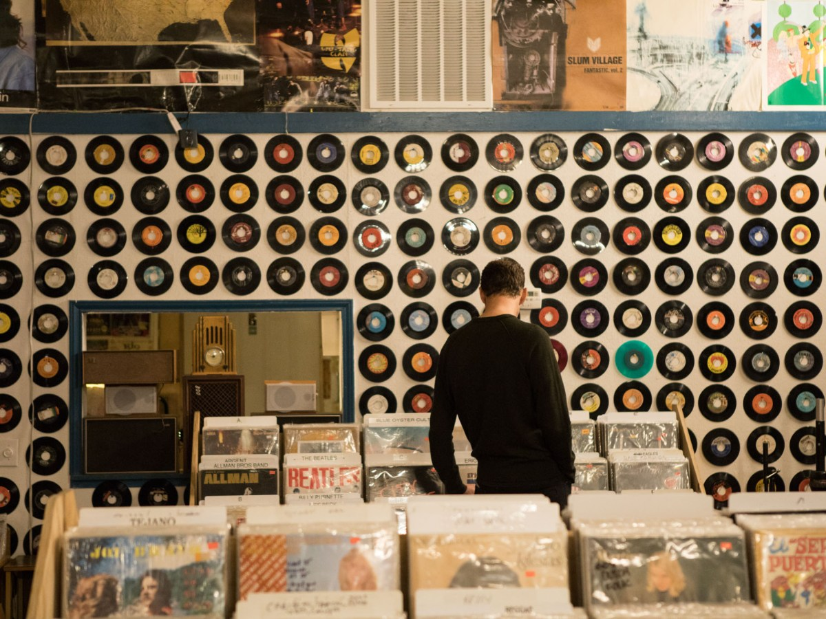 Eric Comstock looks through vinyl at Friends of Sound Records.