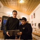 Friends of Sound Records Owner George Mendoza (right) gives his advice on which record to buy to customer Eric Comstock.