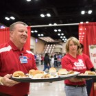 H-E-B partners serve hot meals at the 25th annual H?E?B Feast of Sharing holiday dinner.