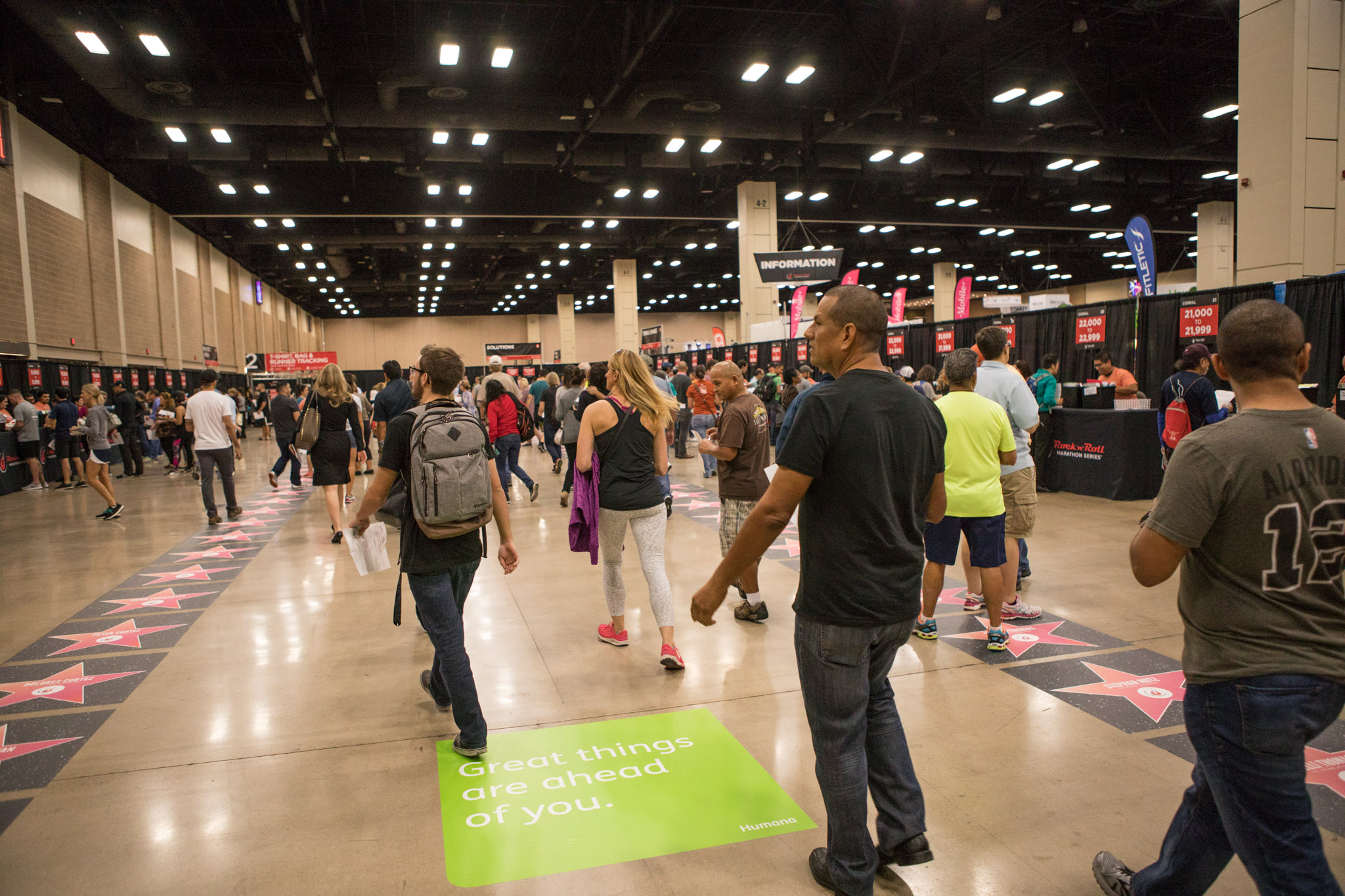 Runners enter Expo Hall to pick up their race numbers for the 10th annual Humana Rock 'n' Roll San Antonio Marathon & ½ Marathon.