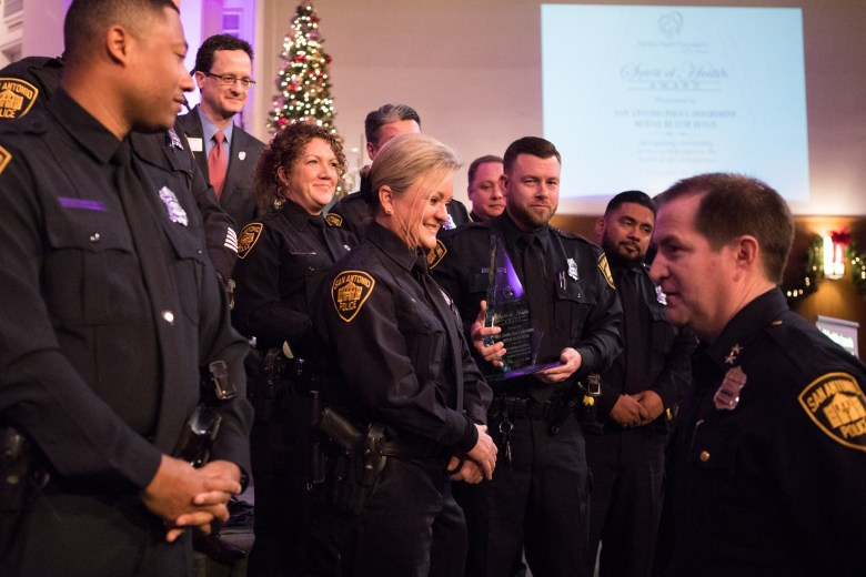 Assistant Chief Anthony Treviño (right) presents the Spirit of Health Award to San Antonio Police Department's Mental Health Detail officers.