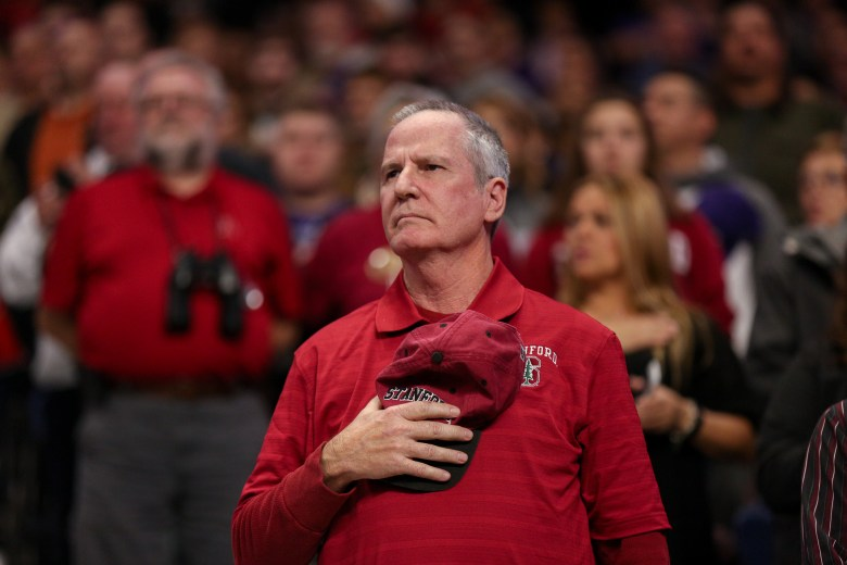 A Stanford fan holds his hat over his heart during the National Anthem.