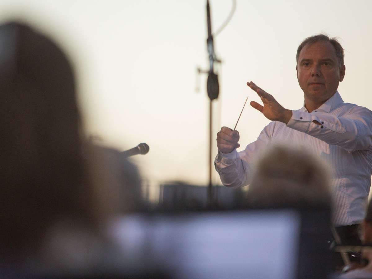 Music Director of the San Antonio Symphony Sebastian Lang-Lessing conducts his orchestra during the groundbreaking of the San Pedro Creek improvements project.