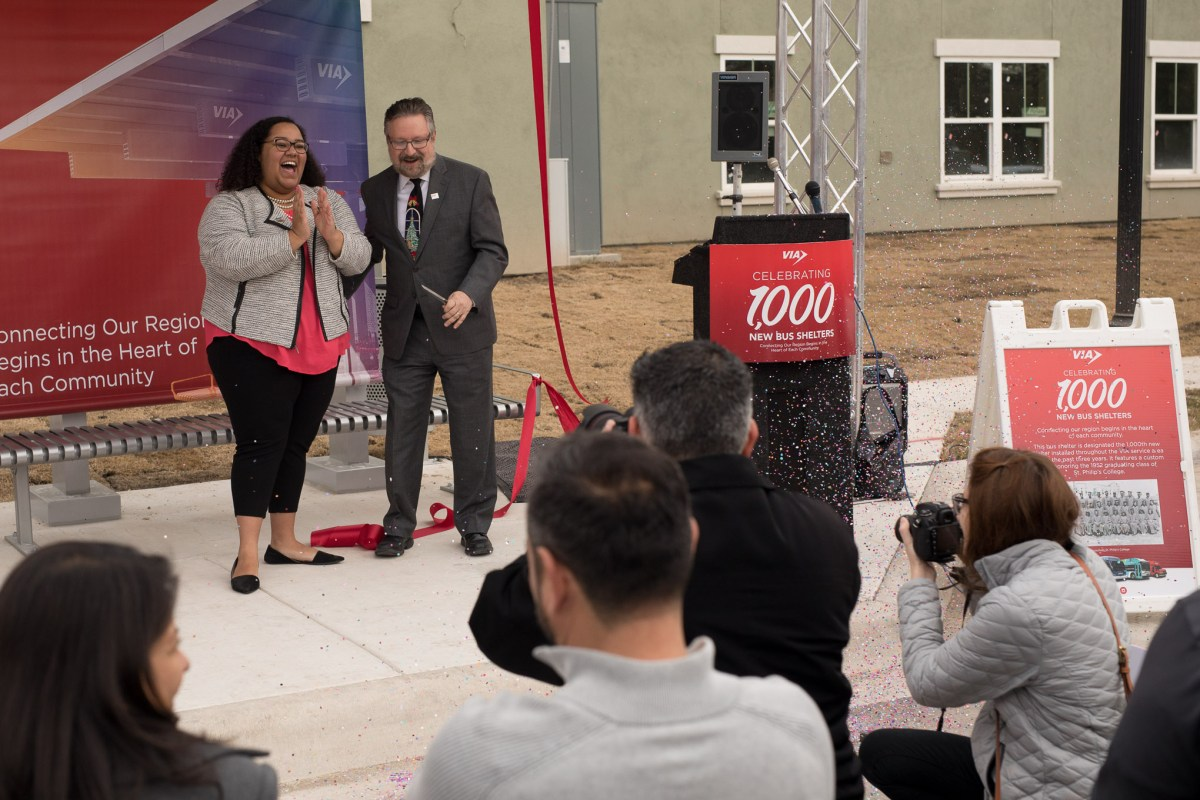Celeste Brown from the District 2 office celebrates with VIA CEO Jeffrey Arndt following the ribbon cutting of the 1000th erected bus shelter.
