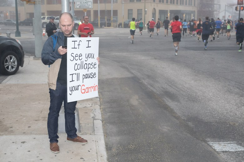 Supporters along the route provide inspirational messages to the runners.