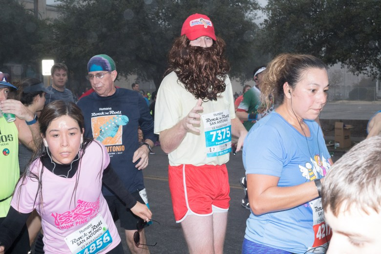 Rock 'n' Roll Marathon participants compete in long distance running through San Antonio, Texas.