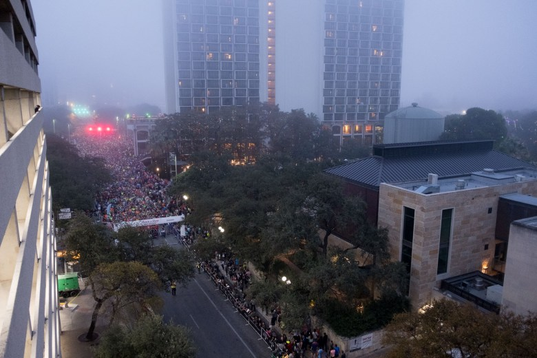 Over 20,000 runners line up at the starting line in downtown San Antonio.