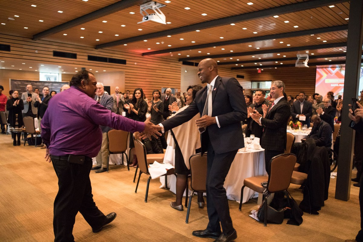 Daryl Davis shakes the hand of Shokare Nakpodia, DreamVoice San Antonio President, after giving the keynote address at the DreamWeek San Antonio 2018 Opening Ceremony Breakfast.